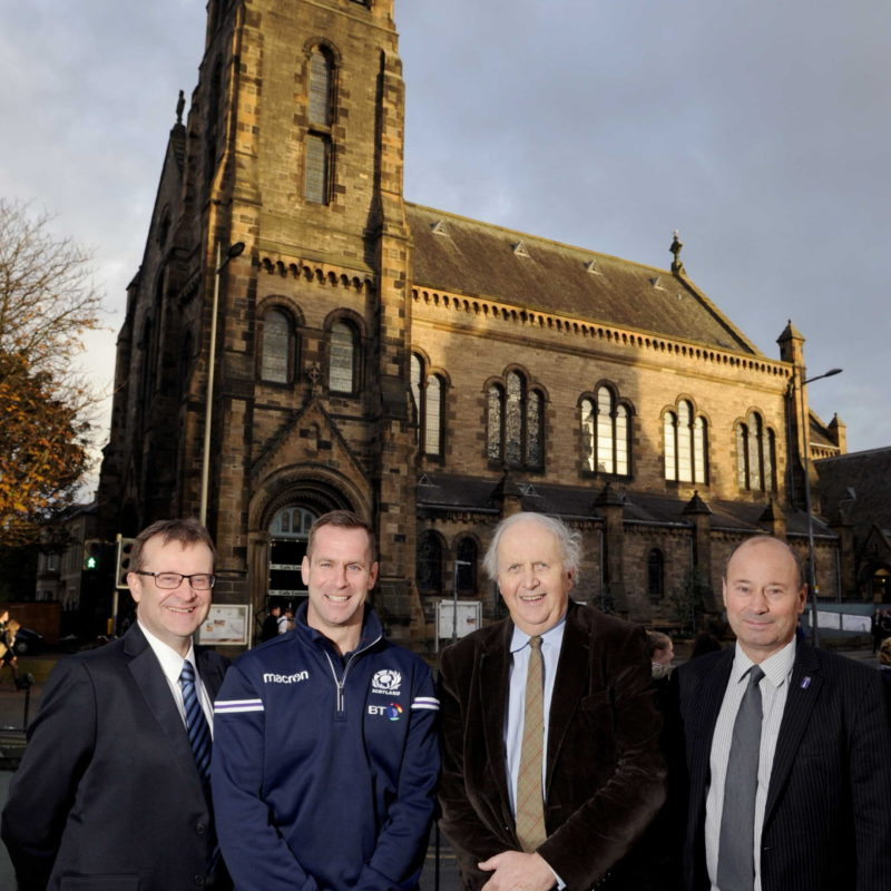 """Alexander McCall Smith and Chris Paterson Launch Eric Liddell Medals Charity Dinner, Edinburgh, 30/10/2017: The two speakers at the Eric Liddell charity dinner - Chris Paterson (Scottish rugby international, centre left) and internationally renowned writer Alexander McCall Smith (centre right) pictured in front of the Eric Liddell Centre, Morningside, Edinburgh, with John MacMillan (left) Eric Liddell Centre chief executive and Alasdair Seale (right, chairman of the board of trustees of the Eric Liddell Centre).   Athlete Eric Liddell was famously portrayed in the """"Chariots of Fire"""" 1981 British film - about his 1924 Paris Olympics sprinting victories. Photography from: Colin Hattersley Photography - www.colinhattersley.com - cphattersley@gmail.com - 07974 957 388."""