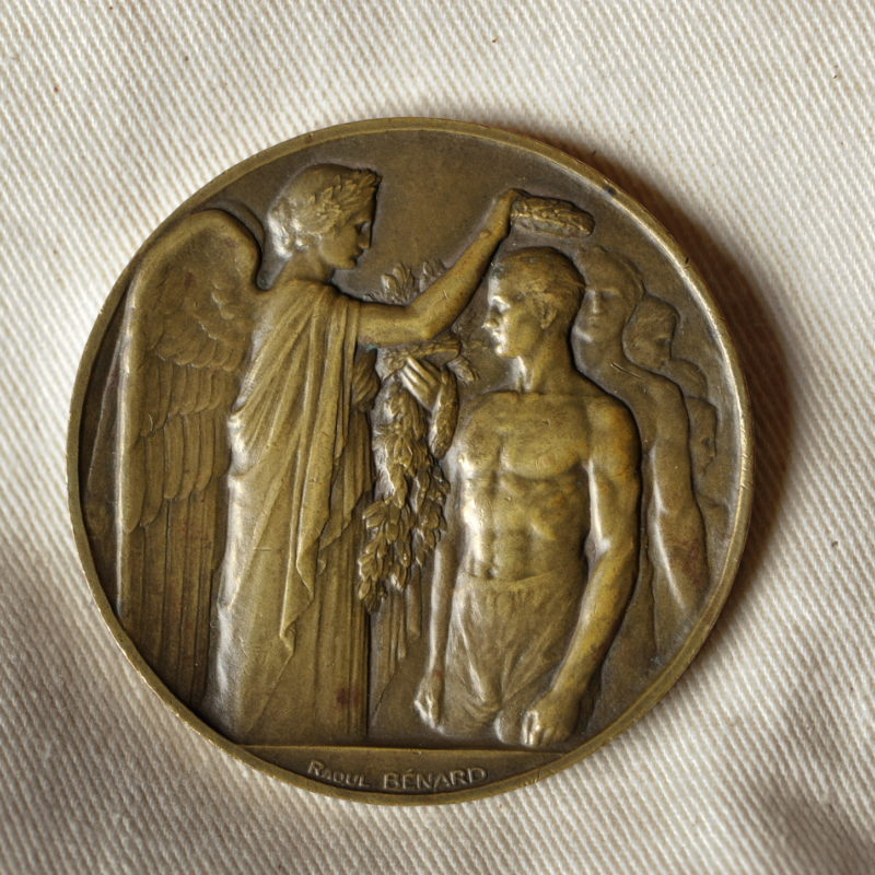 Eric Liddell Medals Charity Dinner, Edinburgh, 30/10/2017: Eric's 1924 Paris Olympic Games participation medal - given to all the athletes who participated in the 1924 Games.    More info from:  Felicity Felicity MacFarlane, Indigo PR - 0131 554 1230 - 07584 672 301 - felicity@indigopr.com Photography from: Colin Hattersley Photography - www.colinhattersley.com - cphattersley@gmail.com - 07974 957 388.